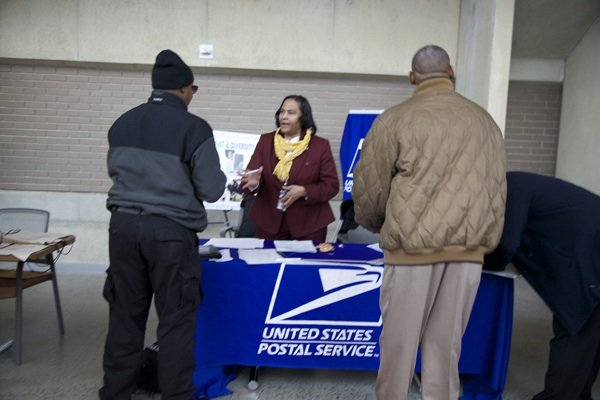 Deborah Evans Atkins, manager of Learning, Development and Diversity, recruits for the U.S. Postal Service during the D.C. Job Fair on March 28 at the Mead Center for American Theater in Southwest.