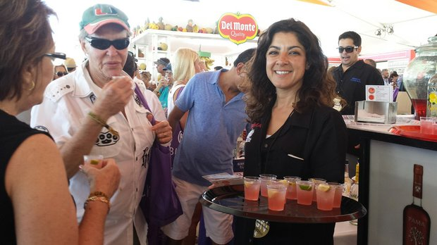 A waitress serves up some fruity cocktails to guests at the event.