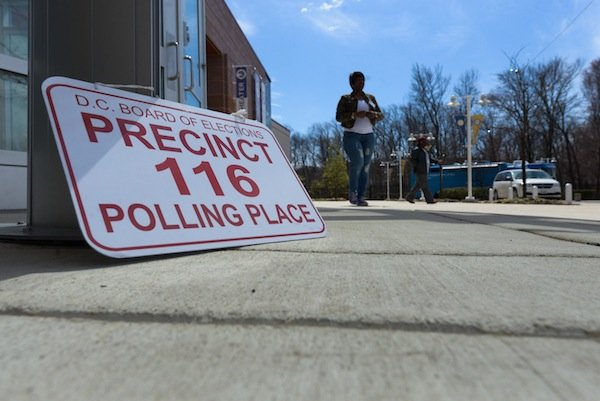 A woman approaches the 116th voting precinct in Southeast D.C. on April 1, the day of the city's Democratic primary election.