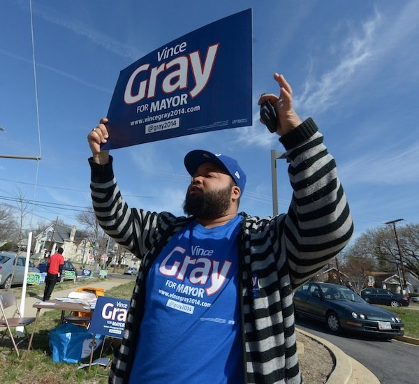 A supporter for D.C. Mayor Vincent Gray campaigns on April 1, the day of the Democratic primary election. Gray faces seven candidates in his re-election bid.