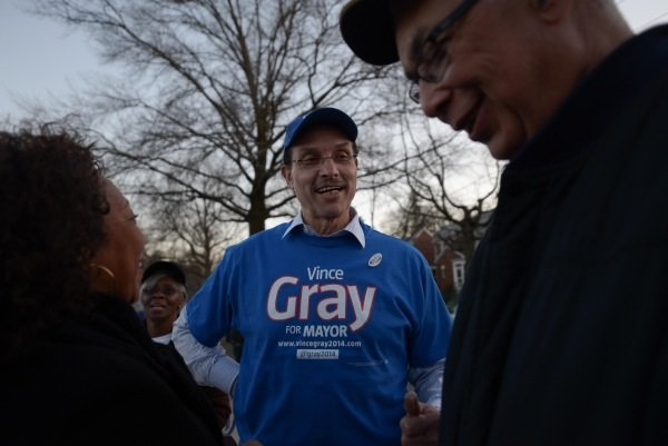 D.C. Mayor Vincent Gray talks with a supporter outside of Polling Precinct 67 at Bunker Hill Elementary School in Northeast on April 1, the day of the city's Democratic primary.