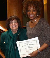 """Spoken word artist Cherrie Amour (right) is congratulated by Maria Mazziotti Gillian (left), executive director of The Poetry Center at Passaic County Community College in Paterson, New Jersey at the 2013 Allen Ginsberg Poetry Reading and Awards Ceremony. Amour was honored for her poem """"Hermoso Negro,"""" which is included in her debut poetry collection """"Free to Be Me: Poems on Life, Love and Relationships."""""""