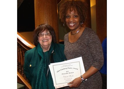 "Spoken word artist Cherrie Amour (right) is congratulated by Maria Mazziotti Gillian (left), executive director of The Poetry Center at Passaic County Community College in Paterson, New Jersey at the 2013 Allen Ginsberg Poetry Reading and Awards Ceremony. Amour was honored for her poem ""Hermoso Negro,"" which is included in her debut poetry collection ""Free to Be Me: Poems on Life, Love and Relationships."""