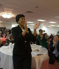 Muriel Bowser, D.C. Democratic mayoral nominee and Ward 4 Council member, stands and applauds the words of former mayoral candidate Rita Jo Lewis during the Democratic Unity Breakfast at Matthews Memorial A.M.E. Church in Southeast on April 5.