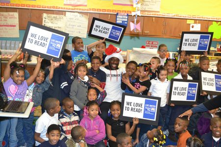 On Friday, March 28, 2014, Baltimore Ravens cornerback Lardarius Webb joined 45 United Way of Central Maryland (UWCM) volunteers to read to elementary-aged children as part of National Reading Month, aiming to promote the importance of early-grade reading.