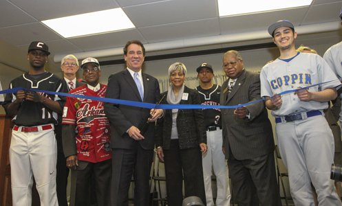 Baltimore County Executive Kevin Kamenetz and Audrey Simmons cut the ribbon a the opening of the Hubert V. Simmons Museum of Negro Leagues Baseball in Owings MIlls.
