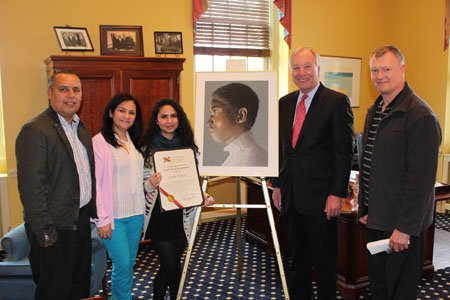 Comptroller Peter Franchot presented a Maryland Masters Award and a Comptroller's Medallion for Making a Difference in the future to North County High School senior, Vivian Tejada at a ceremony recently at his office in Annapolis. (Left to right) Marcio and Mirna Tejada, (parents); Vivian Tejada; the portrait of her friend Adanus; Comptroller Peter Franchot; and art instructor James Dell.