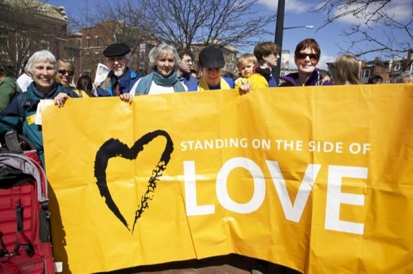 Carol Falk 72, Alan Johnson 73, Kathy Ogle 52, Cathy Rion-Starr 37, Robin Rion-Starr, 1, and Jan Smart, 64, all members of All Souls Church Unitarian in D.C., participate in a rally and march for immigrant rights in Lamont Park in Mount Pleasant on April 5, 2014.