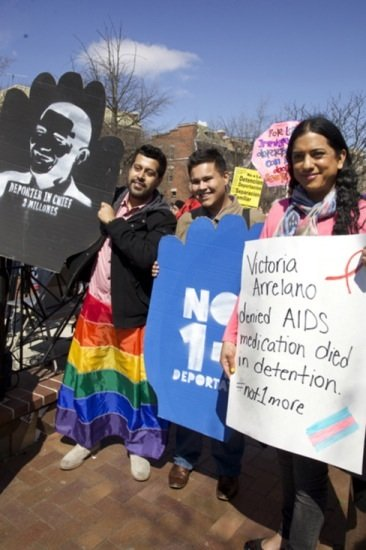 Luis Ramirez, Cesar Vega and Isa Nayola participate in a rally and march in D.C. for immigrant rights in Lamont Park in Mount Pleasant, in support of members of the LGBT community who have been deported.