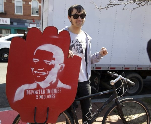 Walker Grooms, 30, readies his bicycle and sign for a march in D.C. for immigrant rights march on April 5, 2014.