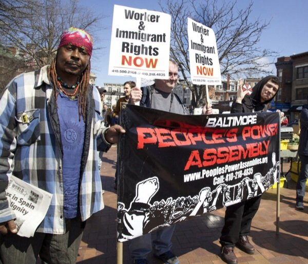Baltimore residents Lee Patterson, 59, Bruce Emmerling, 43, and Brandon Wallace, 27, gather in D.C.'s Lamont Park in the Mount Pleasant neighborhood in Northwest for a march for immigrants rights on April 5, 2014.