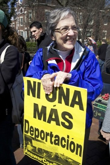 Alice Foltz, 70, holds a poster in D.C.'s Lamont Park in the Mount Pleasant neighborhood in Northwest at a rally for immigrant rights on April 5, 2014.