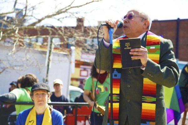 Rev. Jose Palacio of Calvary Baptist Church in Northwest D.C. gives a prayer during a rally in Lamont Park in Mount Pleasant before a march for immigrant rights on April 5, 2014.