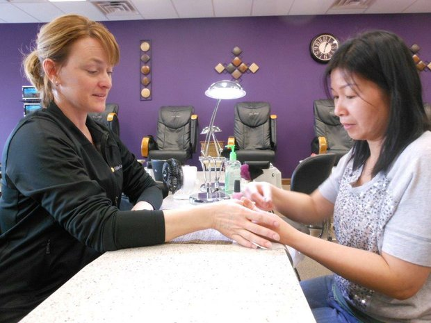 Julie Dzarnowski gets a manicure at Star Nails, 857 Center St, in Shorewood, which could soon be selling wine and beer to customers.