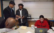 Adalberto Teixeira, Joao DePina and Linda Monteiro tally votes in the campaign office of Evandro Carvalho. Carvalho won the five-way Democratic primary for the 5th Suffolk District seat with 49 percent of the vote.