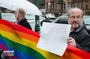 "March 29th, 2014. Protester stands in the rain in front of ATLAH Church in West Harlem. His sign reads,"" Homophobia has got to go!""."