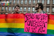 "March 29th, 2014. Two protesters stand in the rain in front of the ATLAH Church in West Harlem. Micah Bucey, a Christian minister in the East Village, holds the sign which reads,"" Jesus was the queerest of them all."""