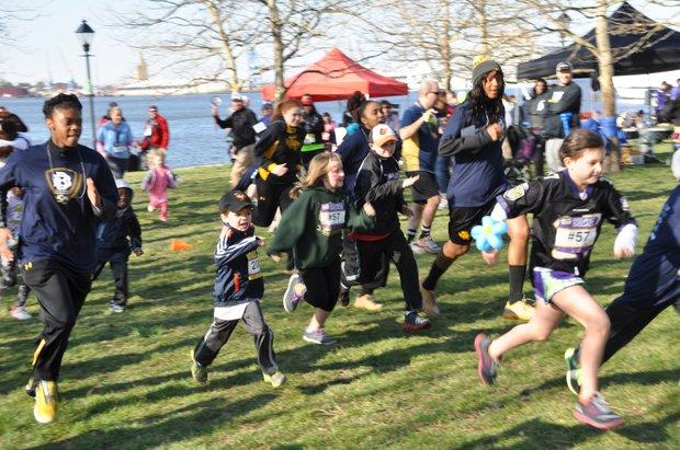 "Children take part in the ""Kids Fun Run.""  Photo Credit: One Rock Studio"