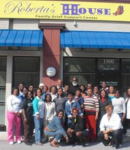 Roberta's House is currently the only organization of its kind that provides bereavement support for the entire family. The facility offers free children and teen peer support groups, adult programs, volunteer training and community education. (Above) Volunteers at Roberta's House after a training seminar.