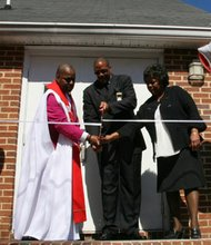 Mt. Calvary United Methodist Church held it's grand re-opening ceremony on the lawn of the church in Arnold, Maryland on Sunday, April 6, 2014. Taking part in the ribbon cutting ceremony with Rev. Dr. Reginald Tarpley, (left) is Bro. Keith Cain and Sis. Norrine Smith.