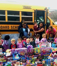 """Items for the """"Stuff the Bus"""" initiative were collected by The Goddard School preschoolers the entire month of March. On Thursday, April 3, 2014, the items were loaded in a school bus and then donated to children undergoing treatment at the Johns Hopkins Children's Center."""