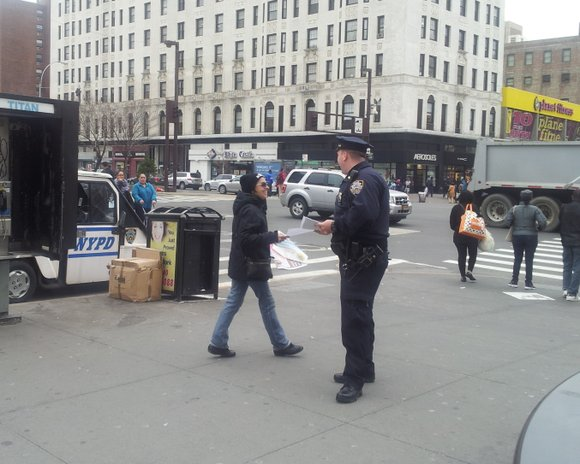 NYPD officers handed out fliers on April 2nd near the notorious intersection of 125th street and Lenox Ave where several ...