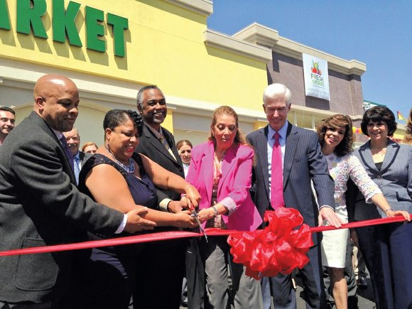 A Latino market that opened in South Los Angeles Monday is providing fresh produce and nearly 200 jobs, including one ...
