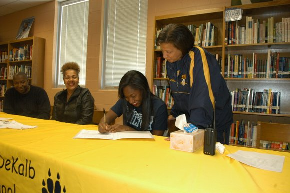 Southwest DeKalb athletes Darsan DeShazier and Lauren Jones inked four-year scholarships at their school on April 16.