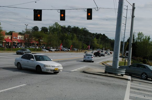 Nine months after it was installed, the traffic signal that will help customers get in and out of businesses along ...