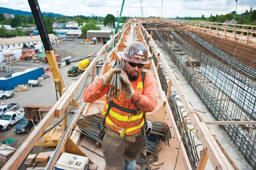 TriMet officials reported a milestone with construction of the Portland-Milwaukie Light Rail Line creating 10,000 jobs so far and a record $153 million in contracts to minority, women and other disadvantaged business firms.