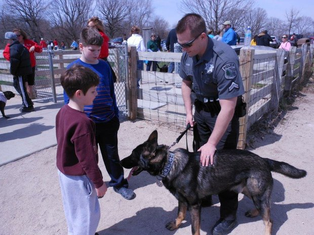 (Left to Right)—Colin and Ian Curless meet Jullo and Will County Forest Preserve Officer Dean Klier.