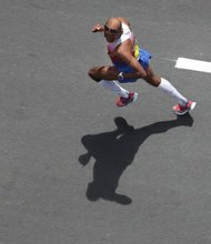 The first American man to win the Boston Marathon since 1983 crossed the finish line Monday, triumphant in a storied race that has become a national symbol of resiliency and determination. Race officials said Meb Keflezighi, 38, won the men's division, with an official time of 2:08:37.