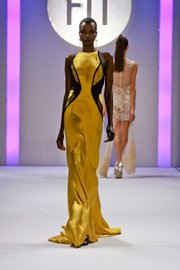 Golden silk satin gown with black lace detail by Jasmine Therese Ruiz
