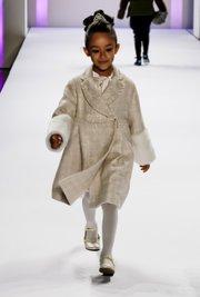 Iridescent tweed coat with blush silk dress by Janine Ramadan