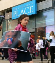 Priya Thompson, 9, was among the demonstrators protesting outside the Children's Place clothing store in D.C.'s Columbia Heights neighborhood on April 24, the one-year anniversary of the collapse of Rana Plaza, an eight-story commercial building in Bangladesh. More than 1,100 people were killed in the collapse, making it the deadliest disaster in the history of the garment industry. The Children's Place, one of the main manufacturers at the plaza before the collapse, has failed to pay the $8 million in compensation owed to victims and family members.