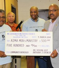 A $500 check was donated to AIMA from Dr. Gist and Mr. Spencer. (Left to right): Ralph Thomas, Dr. James Johnson, Clifton Johnson, Anthony Spencer and Charles Fuller.