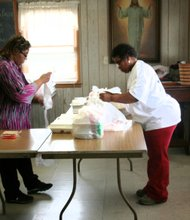 Rolinda McIlwain and Ann Pindell preparing deliveries.