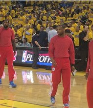 LA Clippers players hit the court for warm-ups wearing the warm-up jerseys backwards as a sign of protest toward owner Donald Sterling. Sterling is accused of making racist remarks in audio recordings recently released.