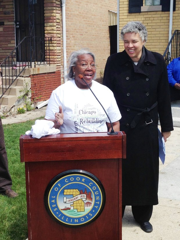Mary Davis (front) speaks in front of her home, 1433 S. Lowe, at a press conference last weekend with Cook County Board President Toni Preckwinkle (back) as part of National Rebuilding Day and Rebuilding Together Metro Chicago's minor home repair project.