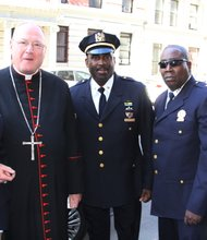 Harlem icon Basil Paterson was funeralized in Harlem at the Church of St. Charles Borromeo on Thursday, April 24.  Photo: (L to R) Chief Saliah of 5 Star Security; Cardinal Timothy Dolan; Michael A. Davidson, deputy inspector of 32nd precinct, Capt Ben 5 Star Security, Deacon Kenneth Radcliffe