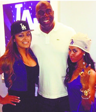 V. Stiviano (right) with Magic Johnson