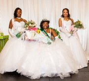 Khadriene Rose Green (center) was crowned Miss Fantasia during the 2014 debutante ball sponsored by the Tealight Foundation and the Kappa Mu Omega Chapter of the Alpha Kappa Sorority. Tyashia Pierce (left) was first runner-up and Kaylah Norris was second runner-up.