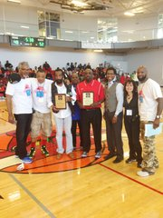 "CUHC organizers: Eric Harrison, Rashard Lewis, one of the founders of the Chicago United Hoops Classic; Ron Eskridge,  Chicago United Hoops Classic Lifetime Achievement Award Recipient; William ""Wolf"" Nelson, Farragut HS Basketball Head Coach; Rob Smith, Chicago United Hoops Classic Lifetime Achievement Award Recipient; Jeffery Hammon, Managing Partner of Chicago United Ventures, LLC; Deanna Nord, Leadership Team Member,  Chicago United Ventures, LLC; and Jeff Maxey pose during the halftime Chicago United Hoops Classic Lifetime Achievement Award  ceremony."