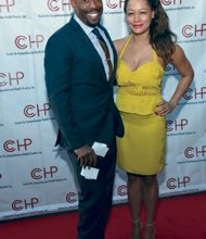 Comic and TV personality Chuck Nice and publicist Jenelle Hamilton at the CCHP and ECDC annual gala