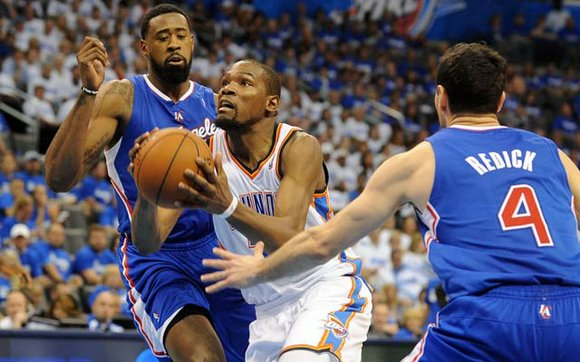 Durant had 32 points, 12 rebounds and nine assists, and the Oklahoma City Thunder beat the Los Angeles Clippers 112-101 ...