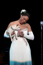 "This photo provided by Jeffrey Richards Associates shows Audra McDonald as Billie Holiday in ""Lady Day at Emerson's Bar & Grill"" while holding Roxie."