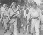 Newson being escorted away from a location near Central High School by Arkansas National Guard troops in 1957.