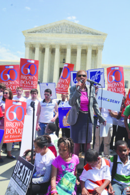 Sixty years after the U.S. Supreme Court scrapped segregation in America's public schools, hundreds of demonstrators gathered at the steps ...