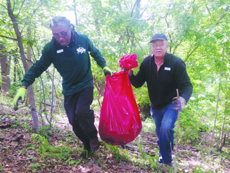 A group of more than a dozen volunteers collected nearly a ton of trash and moved closer to restoring a ...