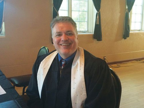Rev. Chuck Currie, from the Center for Peace and Spirituality at Pacific University, said he was honored to marry same-sex couples Monday on the same day Oregon's ban on gay marriages was struck down.